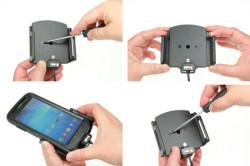Support réglable. Convient appareils avec et sans étui de dimensions: Larg: 75-89 mm, épaiss.: 6-10 mm. Réf 521628